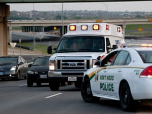 An ambulence makes its way to the base after the shooting.