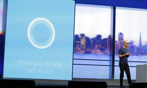 Microsoft CEO Satya Nadella carries on a conversation with the new personal assistant Cortana at the end of his keynote address to the Build Conference Wednesday, April 2, 2014, in San Francisco.