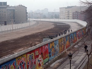 Clean Up. GDR pioneer cleaning squad clearing away waste thrown over the wall from West Berlin