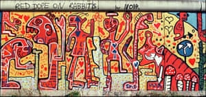 Red Dope on Rabbits, painting by Thierry Noir on Berlin wall at Potsdamer Platz