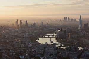 An aerial view of London at sunrise, in June 2012, looking east towards the City with Canary Wharf in the distance.
