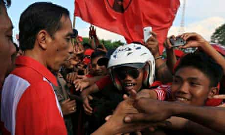 Joko Widodo greets his supporters