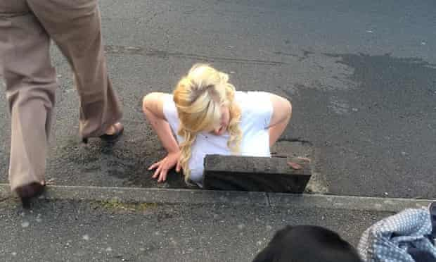 Ella Birchenough being rescued by firefighters after getting stuck in a storm drain while trying to retrieve her mobile phone.