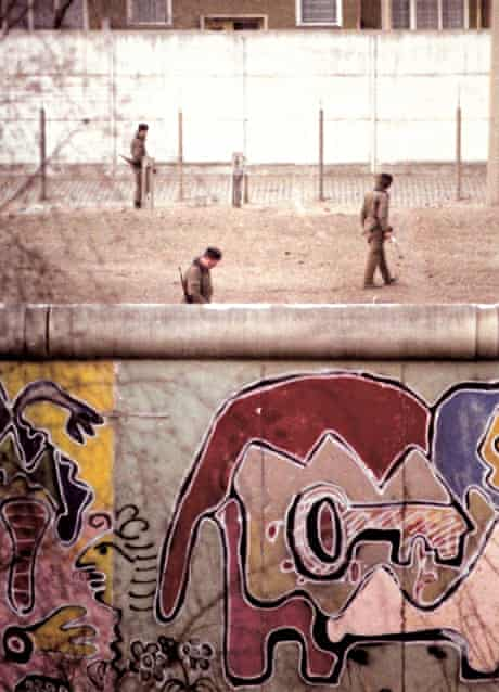 The Berlin Wall: Thierry Noir's artwork and troops in no-man's land