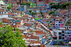 The Medellin slum in Colombia is serviced by outdoor escalators.