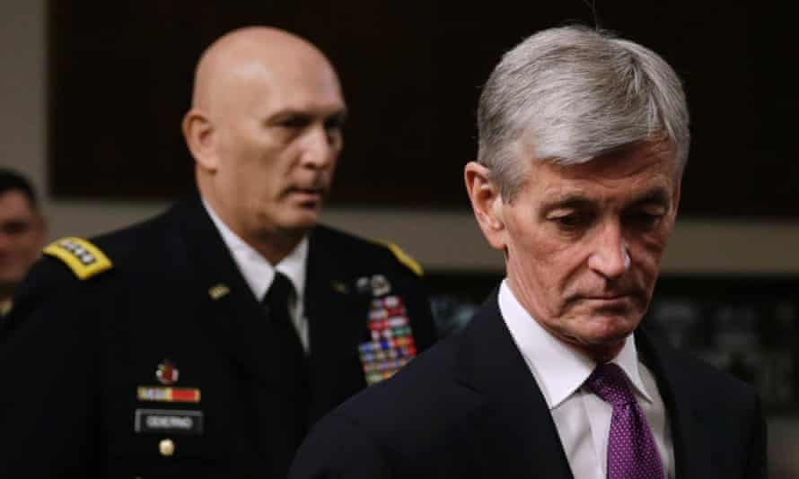 US secretary of the army John McHugh, and army chief of staff General Raymond Odierno, arrive for a session of the Senate armed services committee in Washington.