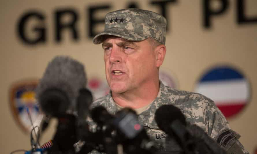 Lieutenant General Mark Milley, the senior officer on Fort Hood, speaks to the media at an entrance to the base.