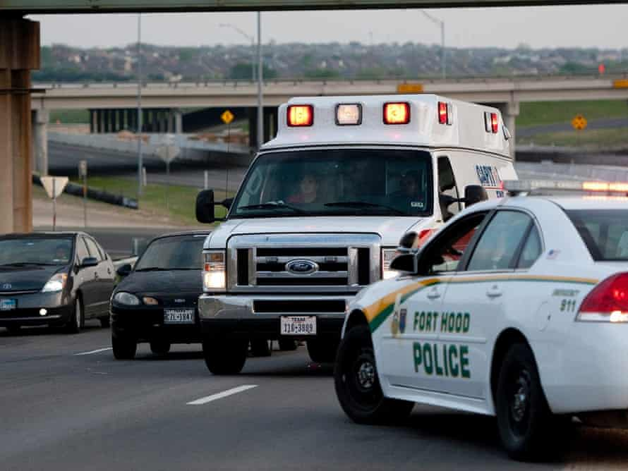 An ambulance makes its way to Fort Hood military base near Killeen after first reports that a shooter was at large.
