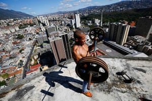 Tower of David: A man lifts weights on a balcony on the 28th floor