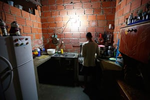 Tower of David: A man cooks in his apartment