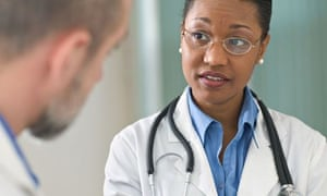 Concerned woman doctor listening to patient