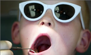 A child having his teeth examined by a dentist