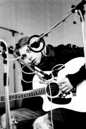 Kurt Cobain, posed, looking to camera, recording in Hilversum Studios, with acoustic guitar.