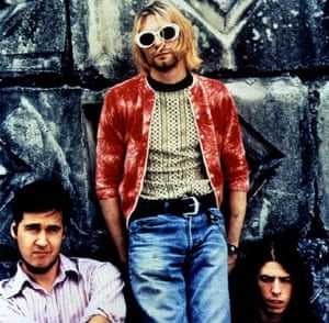 "Cobain is shown in a file photo with ""Nirvana"" members Kris Novoselic (L) and David Grohl."