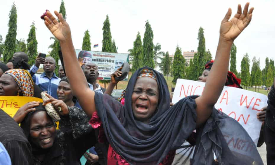 Women hold a demonstration in Abuja over the mass abduction of schoolgirls by Nigerian militants Boko Haram.