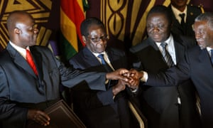 Zimbabwe's President Robert Mugabe (second from left) and Morgan Tsvangirai pose with Thabo Mbeki after signing a power-sharing accord in September 2008 in Harare.