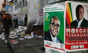 Election campaign posters for Robert Mugabe and his rival Morgan Tsvangirai in 2013.