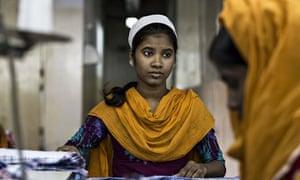 Girl working in garment factory in Dhaka, Bangladesh