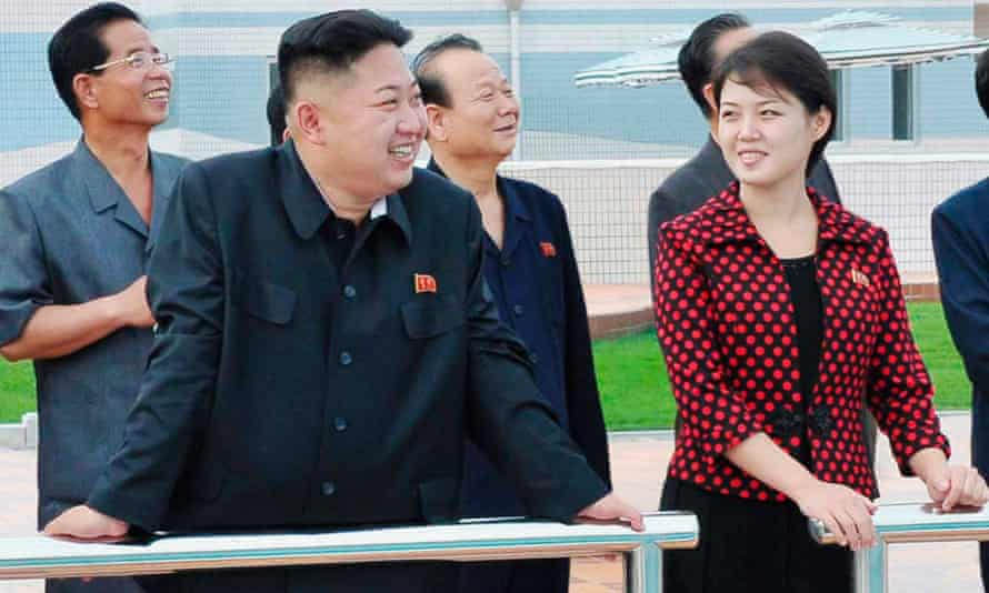 North Korean leader Kim Jong-Un (2nd L) and his wife Ri Sol-ju, pictured by KCNA in 2012