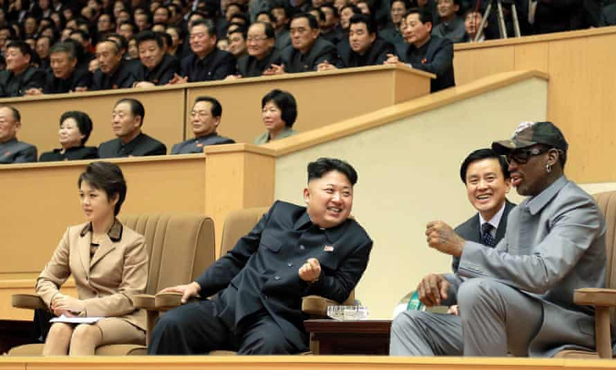 This photo released by KCNA in January 2014 shows Kim Jong-Un (c), his wife Ri Sol-Ju (l) and former US basketball star Dennis Rodman (r) watching a basketball game between former NBA players and North Korean players in Pyongyang.
