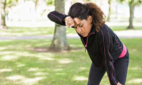 Woman takes a break from jogging