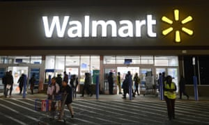 Customers come and go during a sale at a Walmart in Virginia