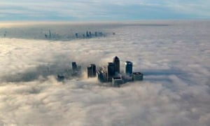 The Canary Wharf financial district emerges from the morning fog.