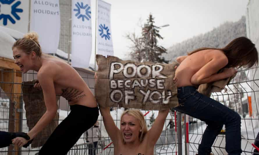 Jan. 28, 2012 photo by Associated Press photographer Anja Niedringhaus. Topless Ukrainian protesters climb up a fence at the entrance to the congress centre where the World Economic Forum takes place in Davos, Switzerland.