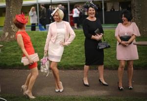 Racegoers enjoy the atmosphere of Ladies Day.