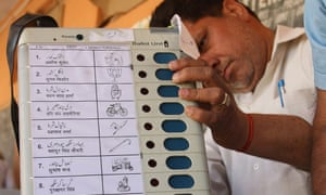An Indian officer examines an electronic voting machine ahead of parliamentary elections in Jammu.
