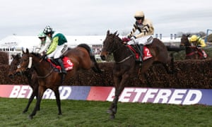 Boston Bob, right, jumps the last and goes on to win  The Melling Steeplechase