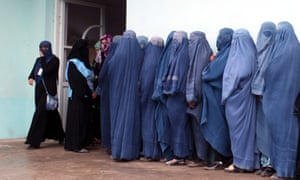 Afghan women line up to vote at a polling station in Takhar.