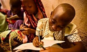 Rwandan girls completing their school work.