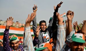 Supporters cheer for Rahul Gandhi