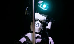 'Female' robot Tess wearing white stilletoes pole dances during a demonstration on the Tobit Software stand at the CeBIT trade fair in Hanover March 10, 2014