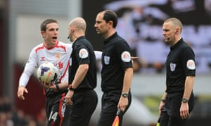 Jordan Henderson continues his protests to referee Anthony Taylor after the half-time whistle.