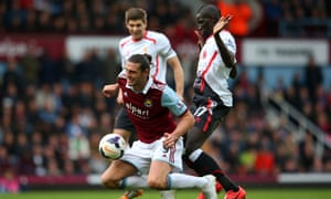Andy Carroll, playing in the false nine position for West Ham, goes down under Mamadou Sakho's challenge.