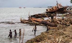 People search through the debris on the beach near the Solomon Islands capital of Honiara.