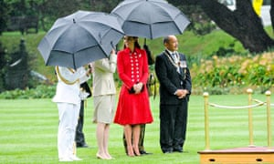 Catherine waits for William to review the guard at an official welcome in Wellington.