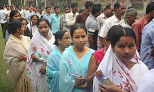 Voters line up to cast their vote outside a womens' polling station in Assam, India.