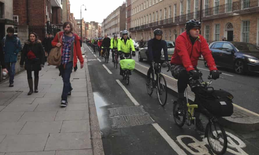Cyclists head to work along London's cycle paths at Tavistock Place during the Tube strike