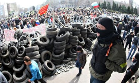Pro-Russian activists guard a barricade in Donetsk