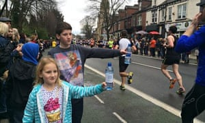 Louis and Grace Mitchell hand out water to Sheffield runners