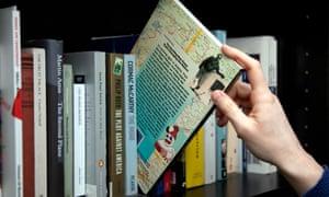 choosing book from a shelf