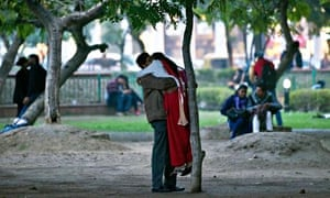 Indians kiss in a park