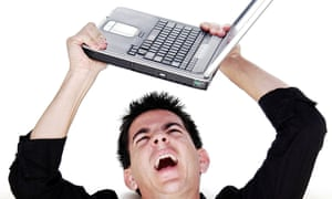 Angry man holding laptop