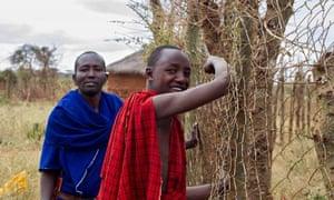 Masai men living wall fence Tanzania
