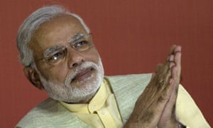 Bharatiya Janata Party leader Narendra Modi listens during a meeting to announce the party's election manifesto on April 7, 2014 in New Delhi.