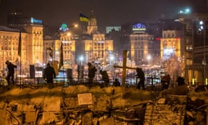 Anti-government protesters build a barricade to block street access to Independence Square in Kiev in December