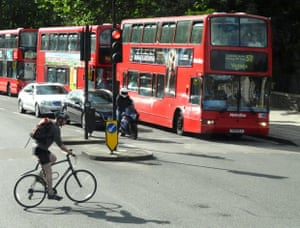 A cyclist commuting across London.
